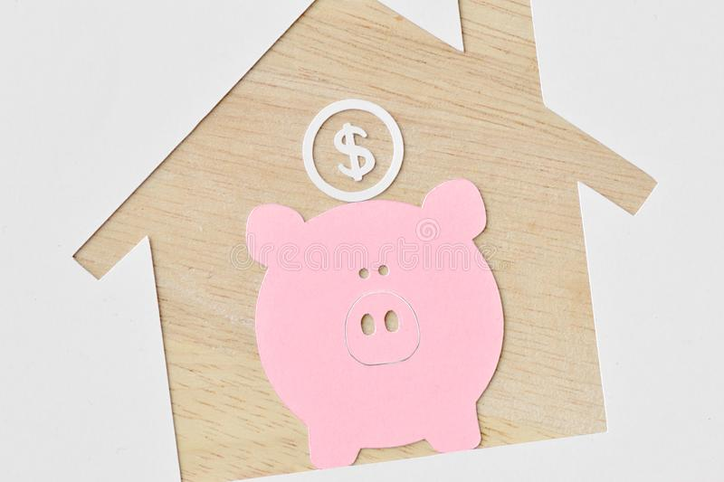 Piggy bank and buying a house project - Saving money for future royalty free stock photos