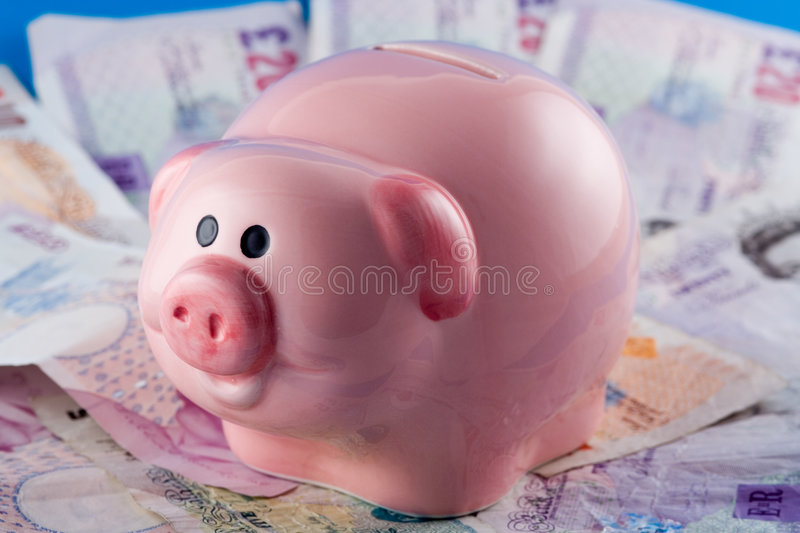Piggy Bank and Cash stock photography