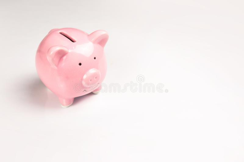 Piggy bank close-up on white stock photo