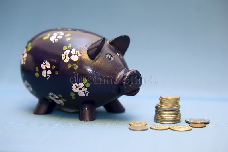 Download Piggy Bank And Coins Royalty Free Stock Photo - Image: 1276635