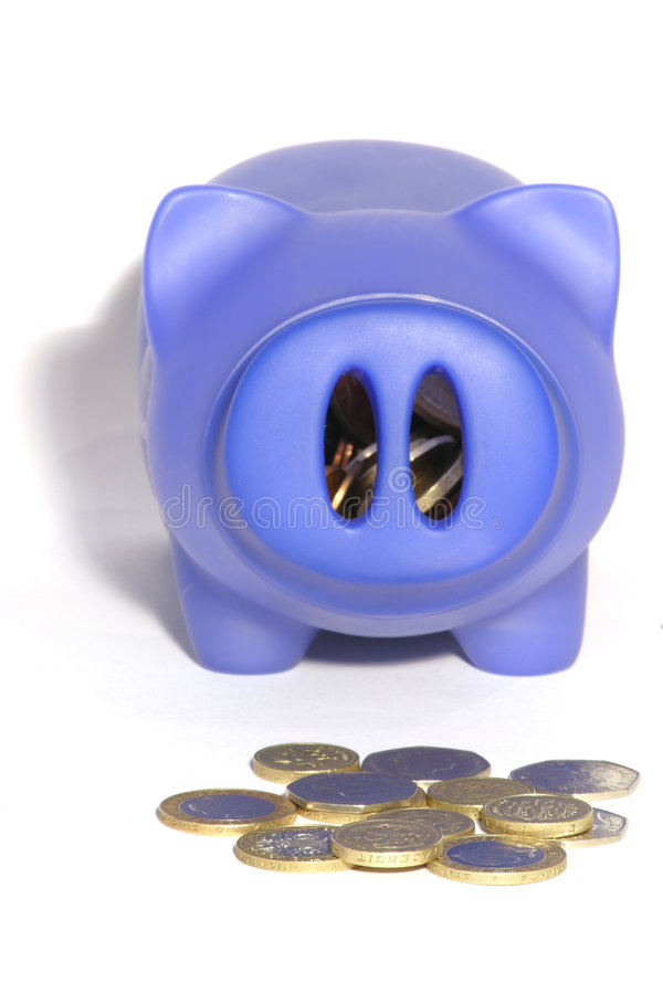 Piggy bank and coins 2 royalty free stock photos