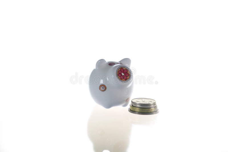 Piggy-bank And Coins Stock Photography