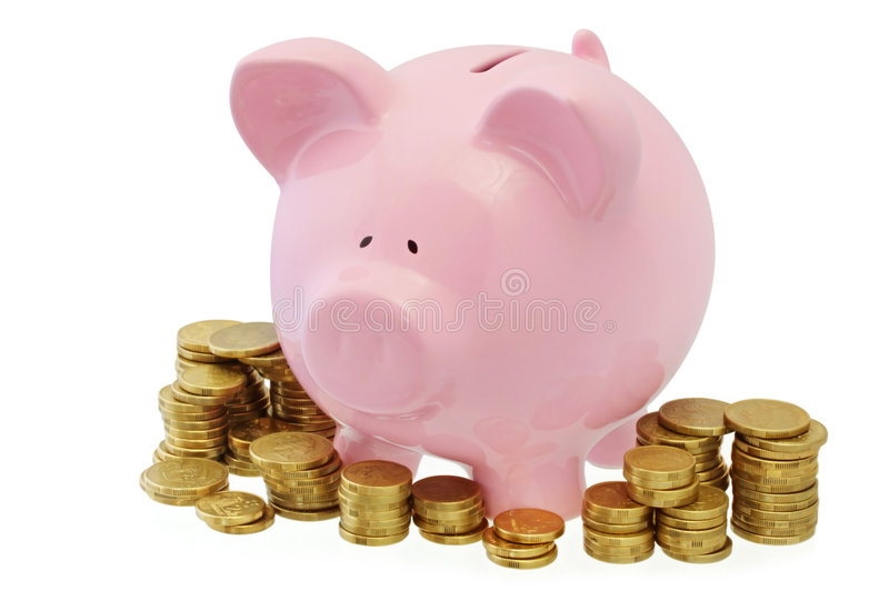 Piggy Bank with Coins. Pink piggy bank surrounded by stacks of gold coins stock images