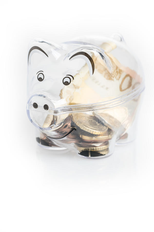 Piggy bank, coins and euro bills. Money saving concept. Banknotes closeup stock photography
