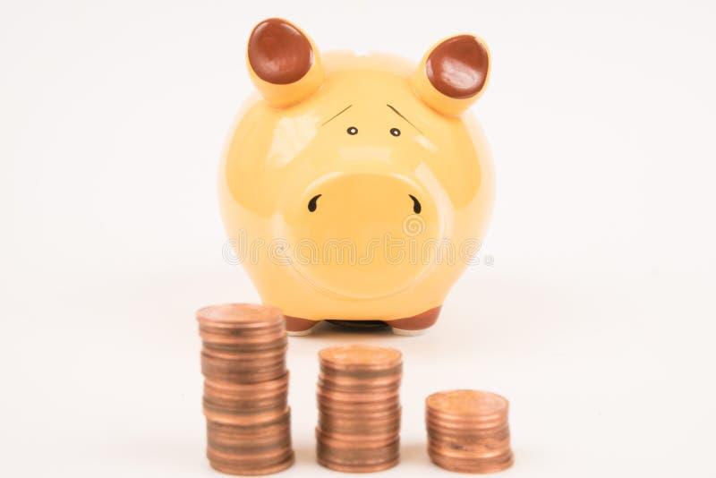 Piggy bank coins stock image