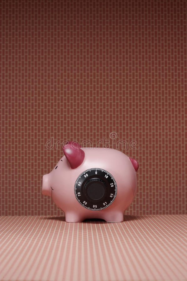 Piggy bank with combination lock side view royalty free stock image