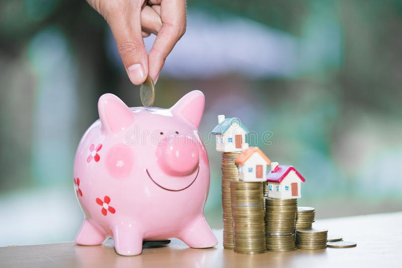 Piggy bank, concept of saving money for house, Business Finance and Money concept,Save money for prepare in the future.  royalty free stock photo