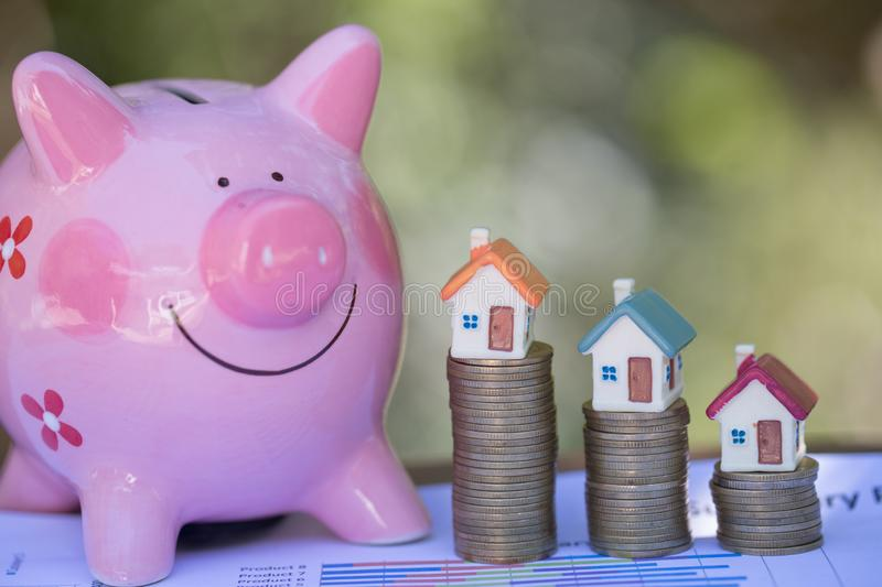 Piggy bank, concept of saving money for house, Savings money for buy house and loan to business investment for real estate concept. Invesment and Risk stock photo