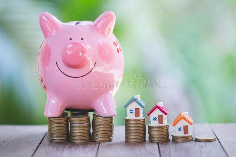 Piggy bank, concept of saving money for house, Savings money for buy house and loan to business investment for real estate concept. Invesment and Risk royalty free stock images