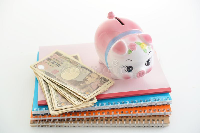 Piggy bank with money. Piggy bank on the desk stock images