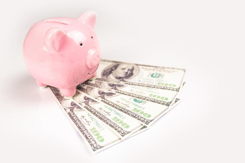Piggy bank and dollar bills stock photography