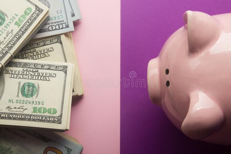 Piggy bank and dollar cash money. Business, finance, investment, saving and corruption concept. Piggy bank and dollar cash money. Business, finance, investment royalty free stock photos