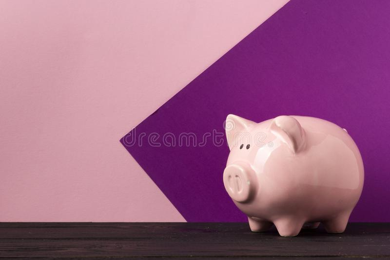 Piggy bank and dollar cash money. Business, finance, investment, saving and corruption concept. Piggy bank and dollar cash money. Business, finance, investment royalty free stock photo