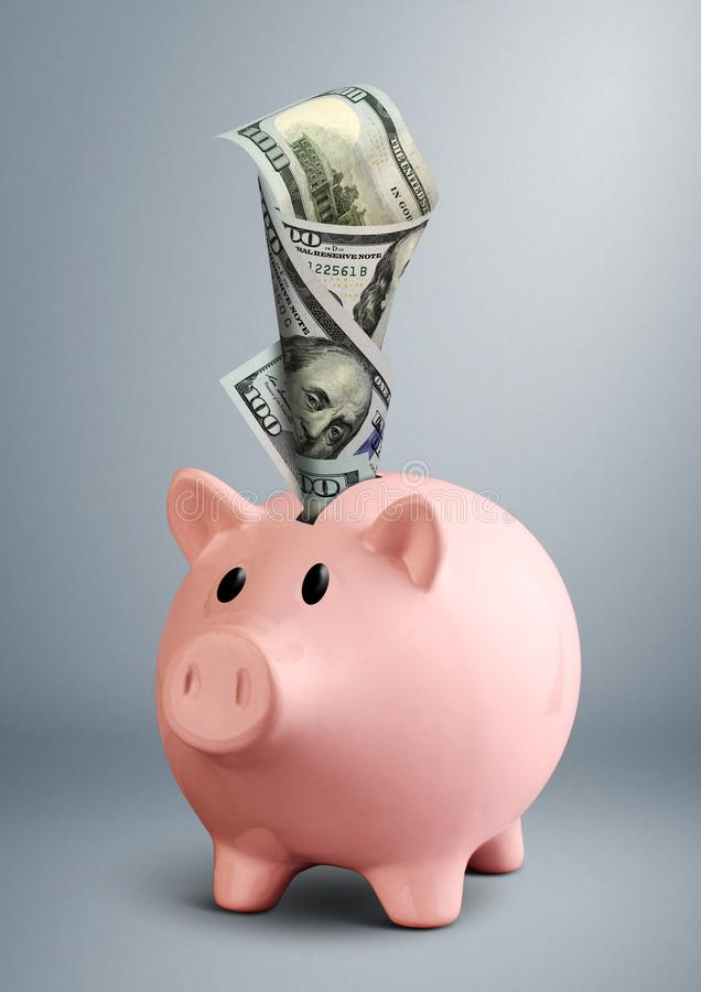 Piggy bank with dollar on grey background royalty free stock photos
