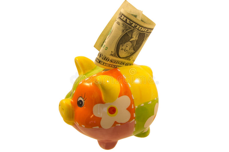 Piggy bank and a dollar note over white. Colorful money box with money isolated on white stock images