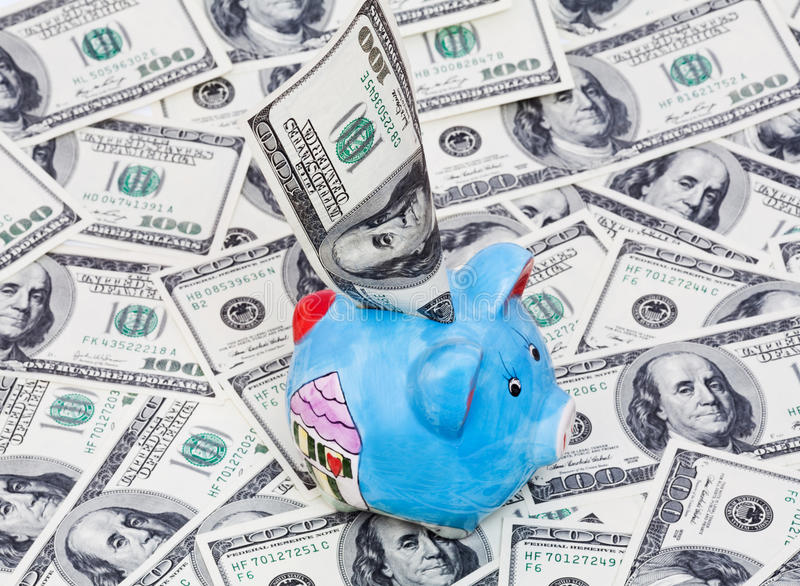 Download Piggy Bank On Dollars Background Stock Image - Image: 11612495