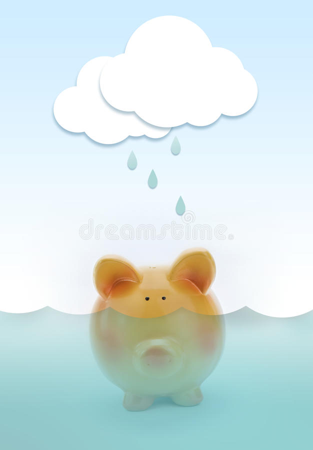 Piggy bank drowning in water stock images