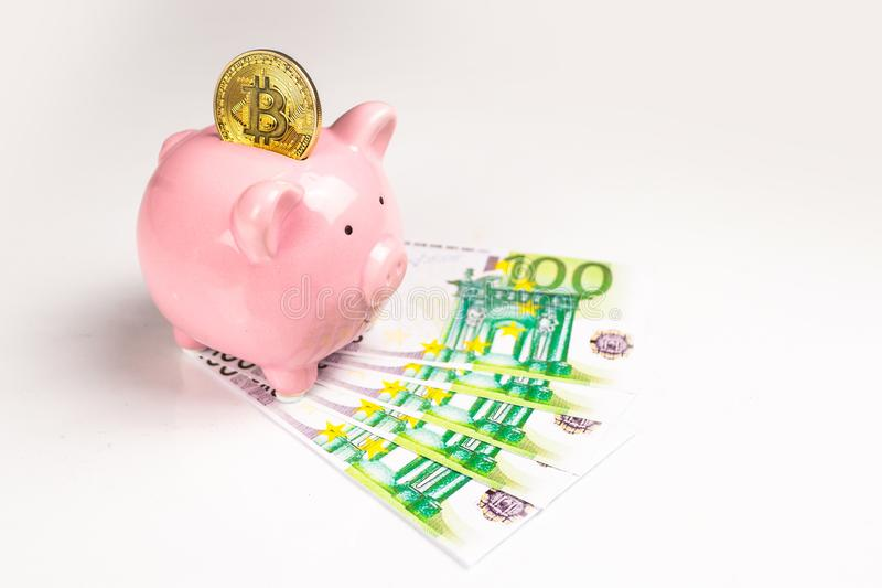 Piggy bank and euro bills and bitcoin royalty free stock photos