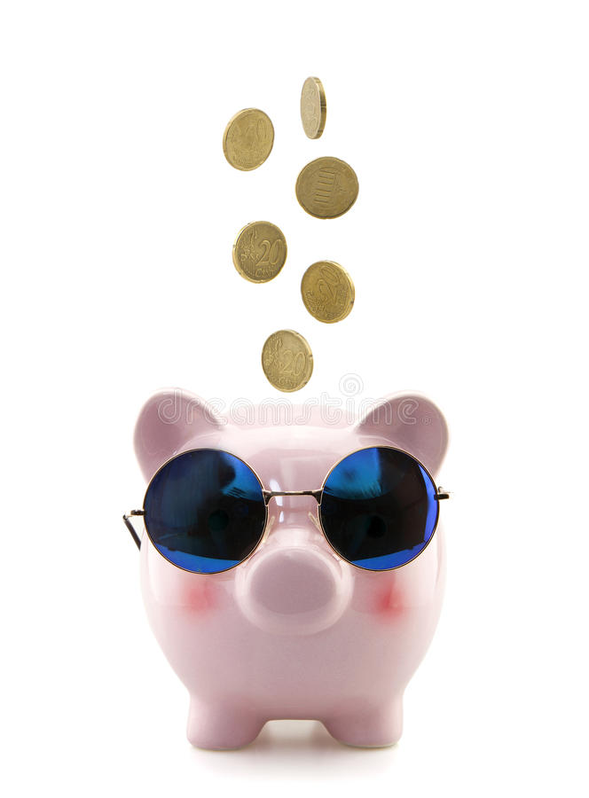 Piggy bank with glasses and falling coins stock photo