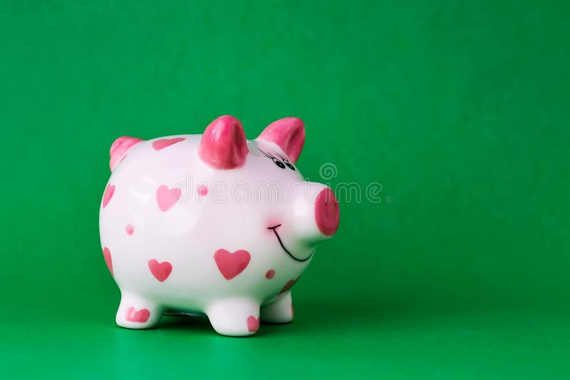 Piggy bank on green background. Copy space. Finance. Preservation. royalty free stock photography