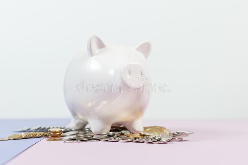 Piggy bank with growth coins royalty free stock photos
