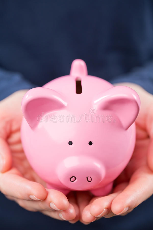 Piggy Bank In The Hands Of A Woman Stock Photography