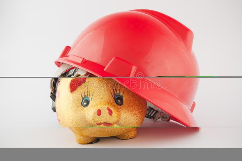 Piggy bank in helmet royalty free stock photo