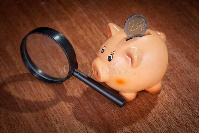 Piggy bank and two euro coin royalty free stock photo