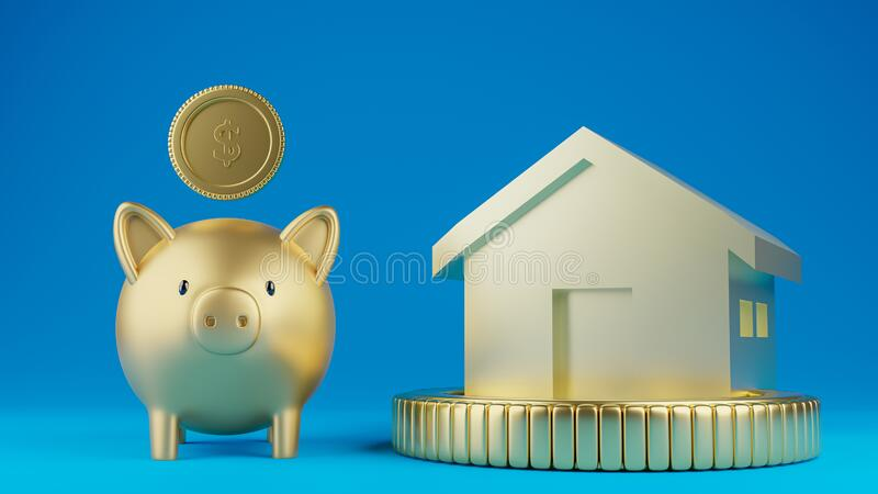 A piggy bank and a house model royalty free stock image