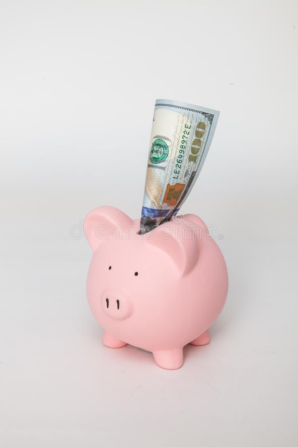 Piggy Bank with $100 sticking out royalty free stock photography