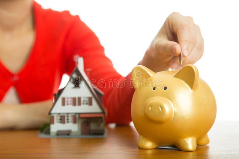 Piggy bank increasing your finance growing for buy model house royalty free stock photos