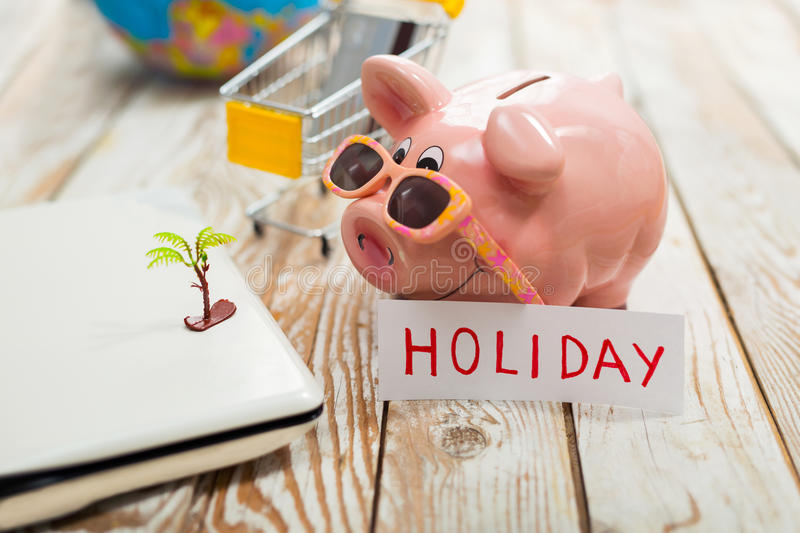 Piggy bank, laptop, globe, credit card - holiday concept. Piggy bank, laptop, globe, - holiday concept royalty free stock photo