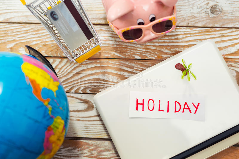 Piggy bank, laptop, globe, credit card - holiday concept. Piggy bank, laptop, globe, - holiday concept royalty free stock image