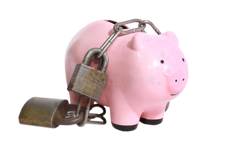 Piggy bank with locks. Piggy bank surounded by padlocks stock images