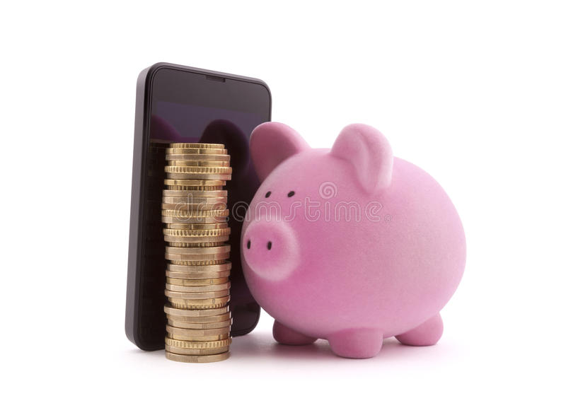 Piggy bank with mobile phone and euro coins royalty free stock images