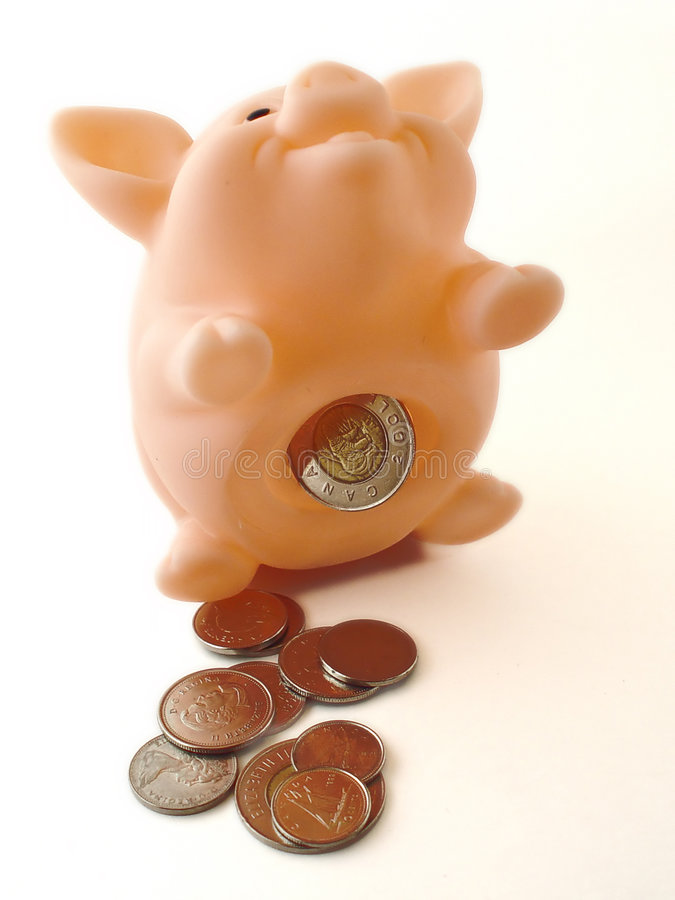 Piggy Bank with Money 2. Piggy bank sitting up with money around it stock photography