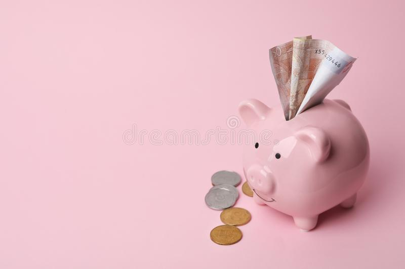 Piggy bank with money royalty free stock images
