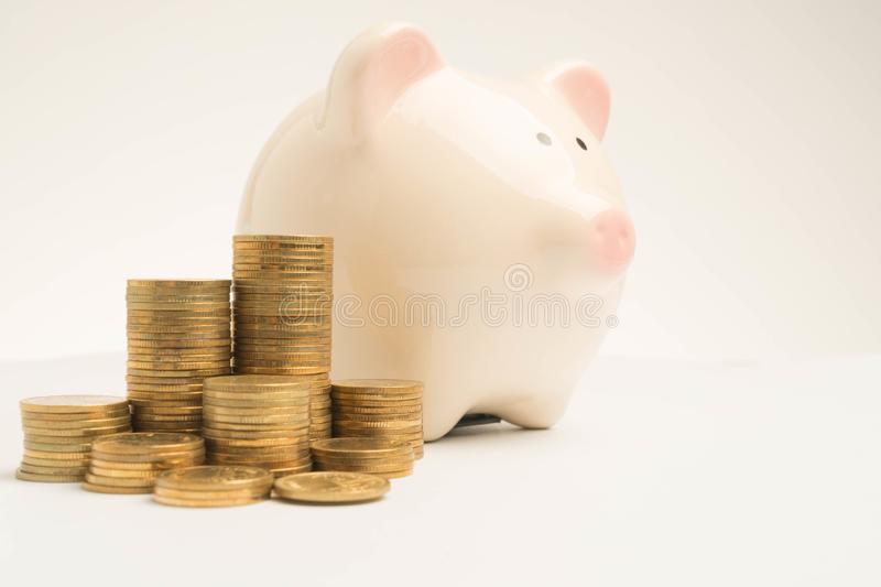 piggy bank and money tower isolated stock image