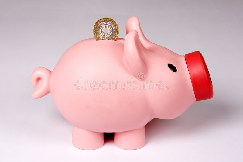 Piggy bank with one coin. stock image
