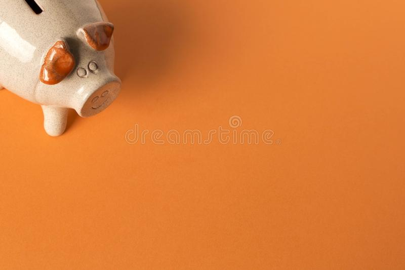 Piggy Bank on the orange background. Close up. The concept of saving money. Selective focus stock images