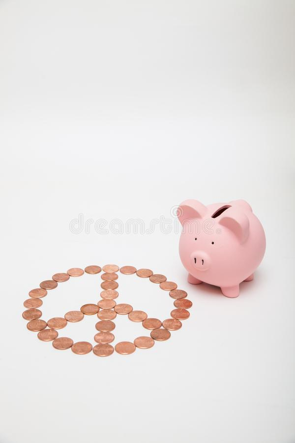 Piggy Bank with a peace sign stock images