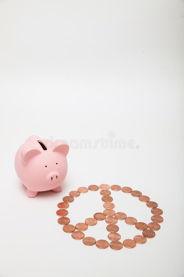Piggy Bank with a peace sign stock image