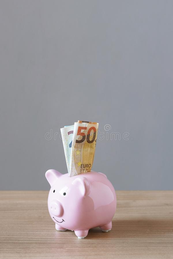 Piggy bank or piggybank filled with euro bills stock photography