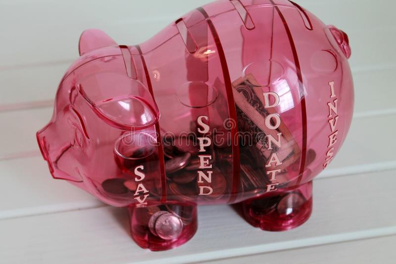 piggy bank with money and coins for saving money royalty free stock photos