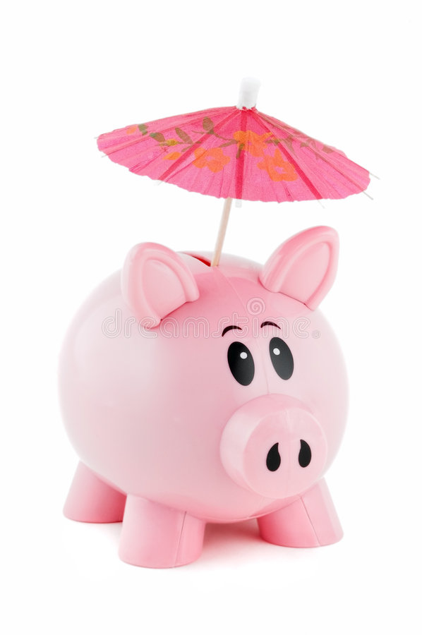Piggy Bank With Pink Umbrella. Sticking out of coin slot royalty free stock photography
