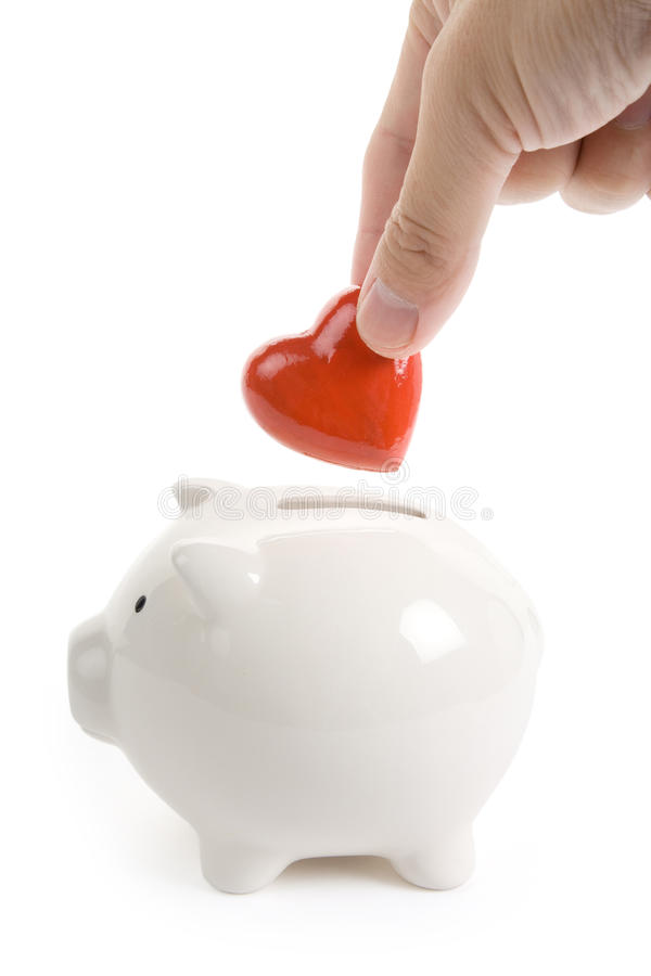 Piggy Bank and Red Heart. Concept of love, Charity and Relief Work