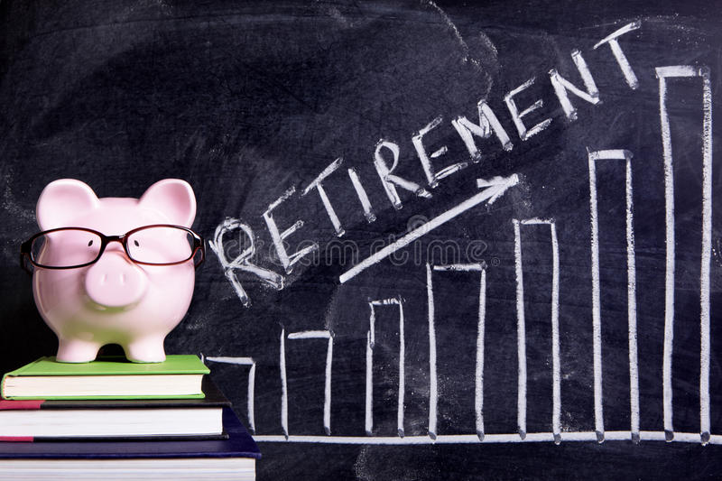 Retirement plan piggy bank savings growth planning. Pink piggy bank with glasses standing on books next to a blackboard with retirement savings message. Sharp royalty free stock photo