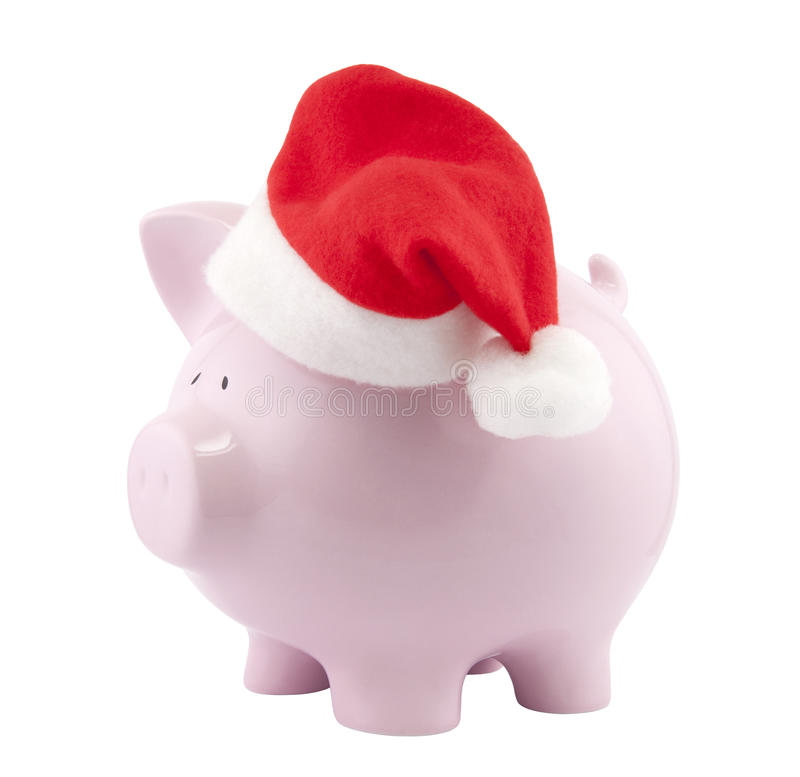 Piggy bank with Santa Claus hat stock photo