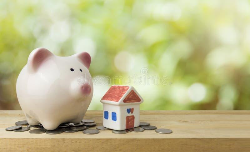 Piggy bank save money for house , saving money concept.  stock photography