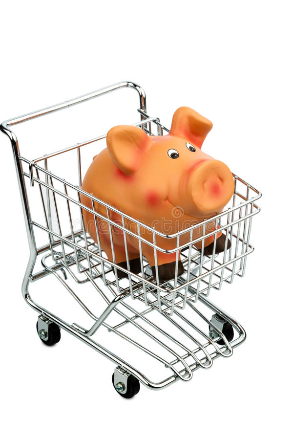 Piggy bank. A piggy bank in a shopping cart, photo icon for consumer prices and buying behavior stock images